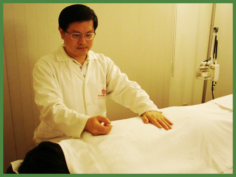 patient receiving massage treatment from Dr. Liu